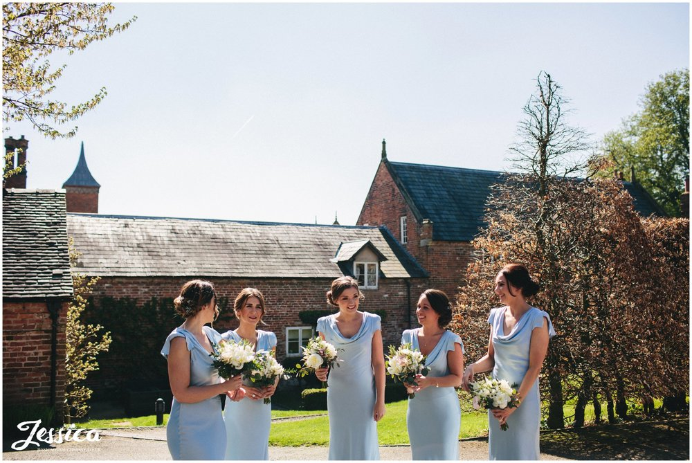bridesmaids wait for the bride before her ceremony - Combermere Abbey wedding photographer
