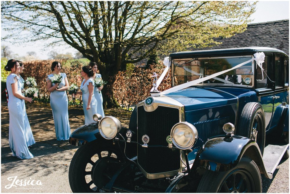 Combermere Abbey wedding car drops the bride off for her ceremony in the glasshouse