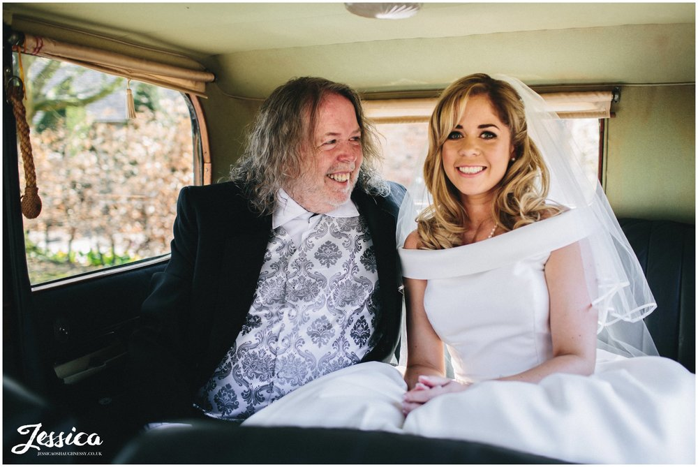 bride & her father in the Combermere Abbey wedding car, shropshire