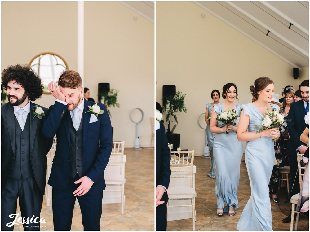 groom cries as the bridesmaids walk down the aisle