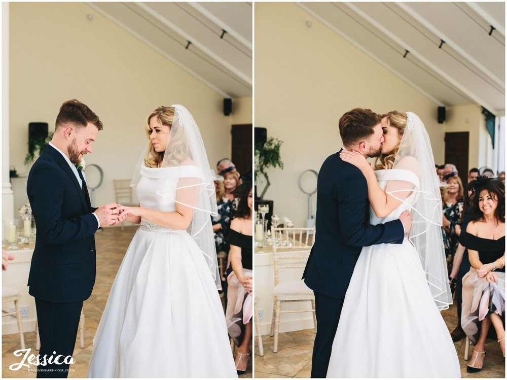 the first kiss during the wedding ceremony at Combermere Abbey in whitchurch