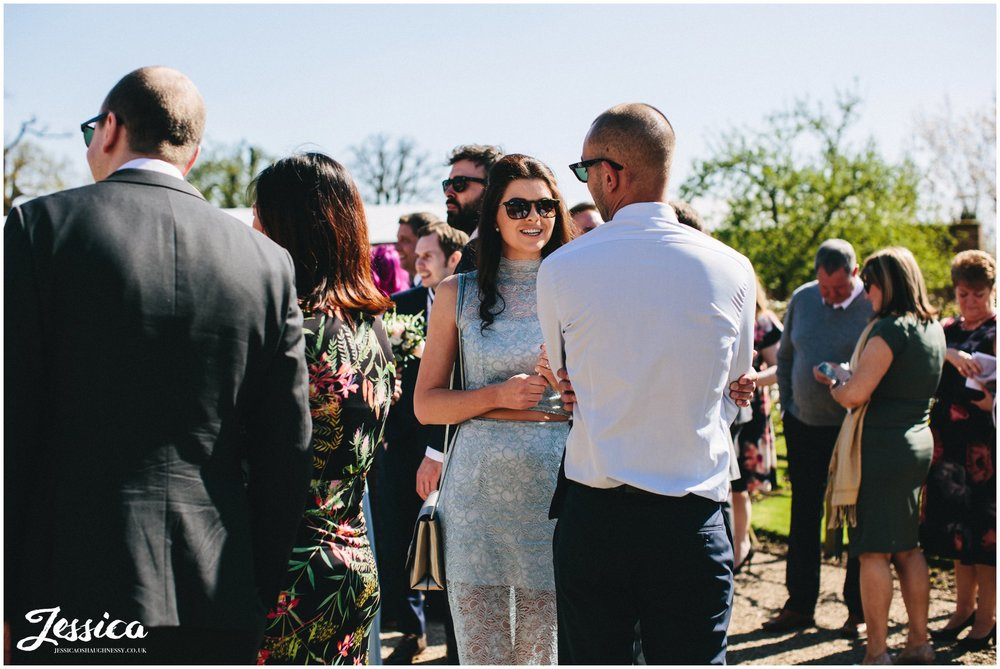 wedding guests during the drinks reception at Combermere Abbey
