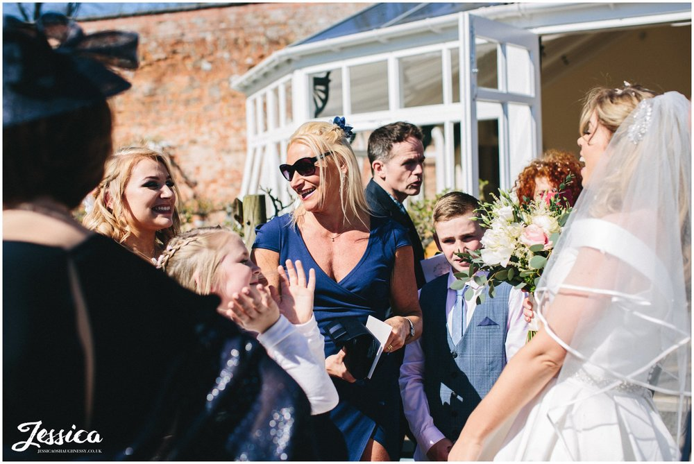 guests congratulate bride after the ceremony in shropshire