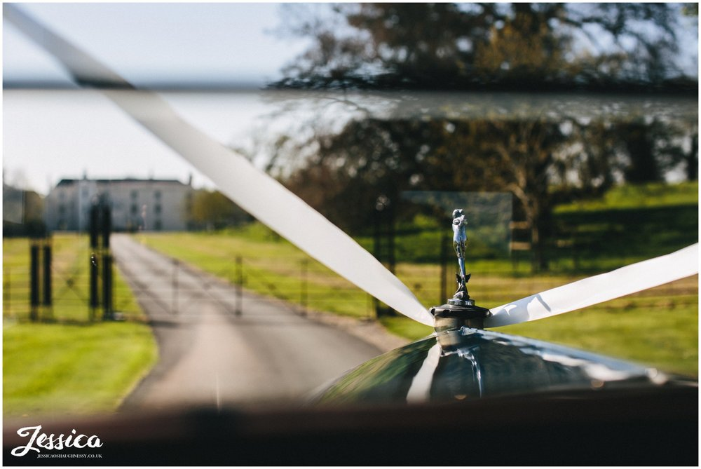 Combermere Abbey's wedding car drives couple to lake