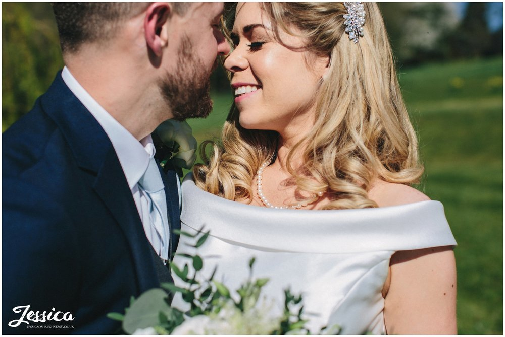 Combermere Abbey - couple embrace on their wedding day