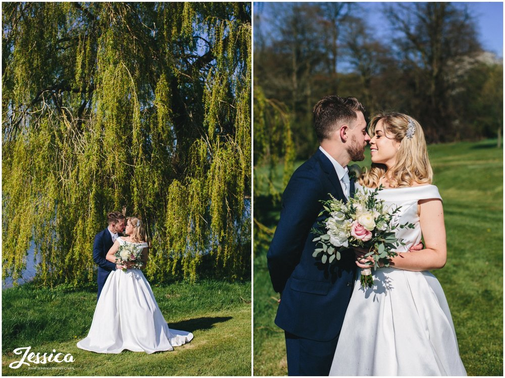 couple kiss on their sunny wedding day in whitchurch