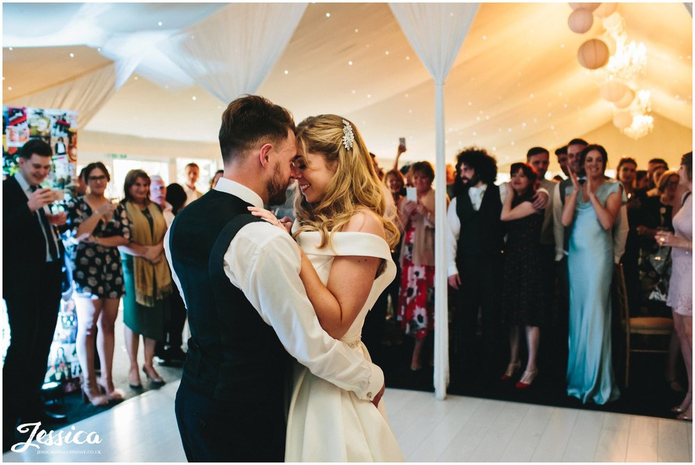 bride & groom share first dance in the pavilion at Combermere Abbey