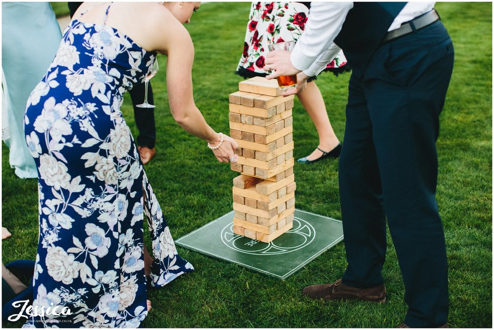 wedding guests play jenga at Combermere Abbey wedding