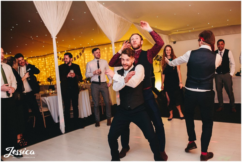 groom dances with his friend