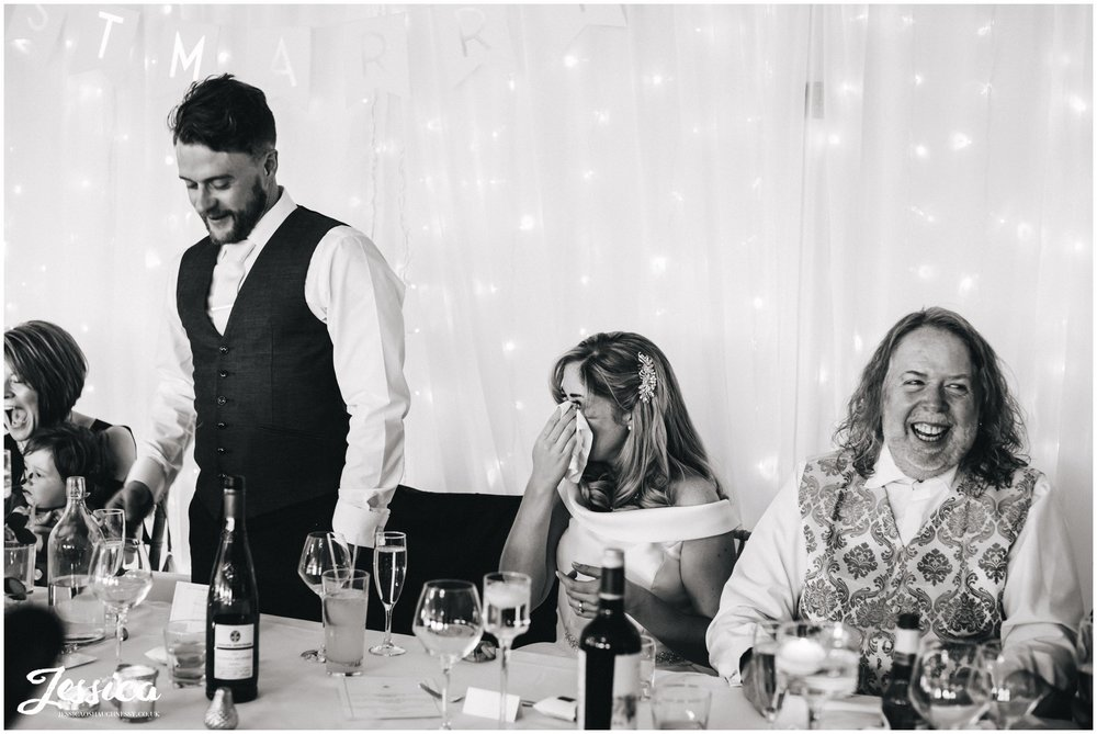 bride cries during the grooms speech on their wedding day at Combermere Abbey