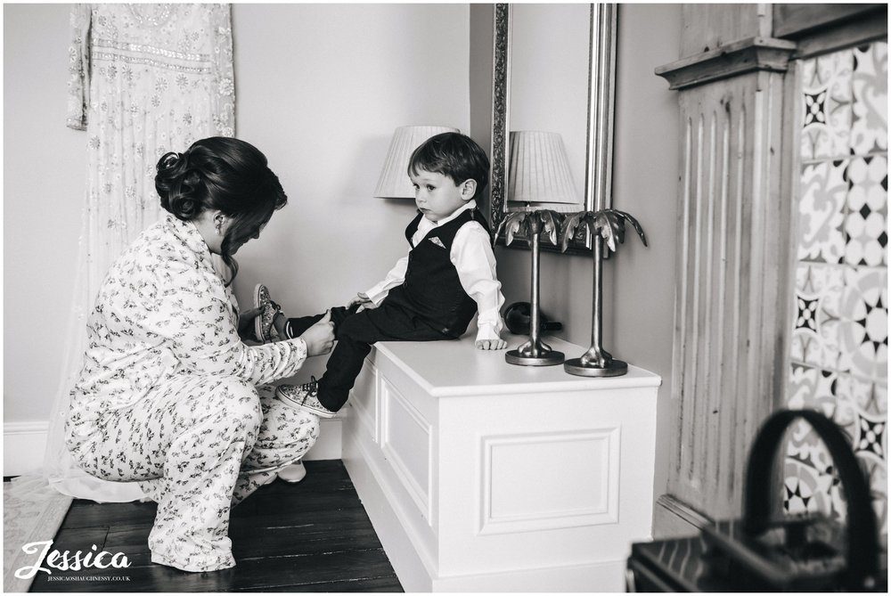 bride puts on her son's shoes ready for the north wales wedding