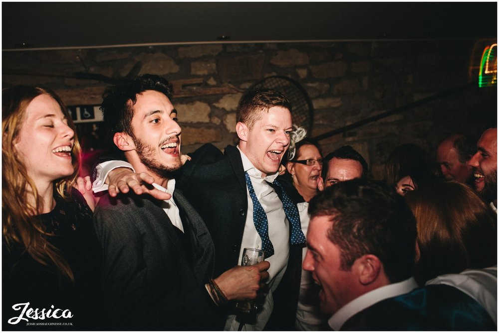 groom dances with friends during his wedding in north wales