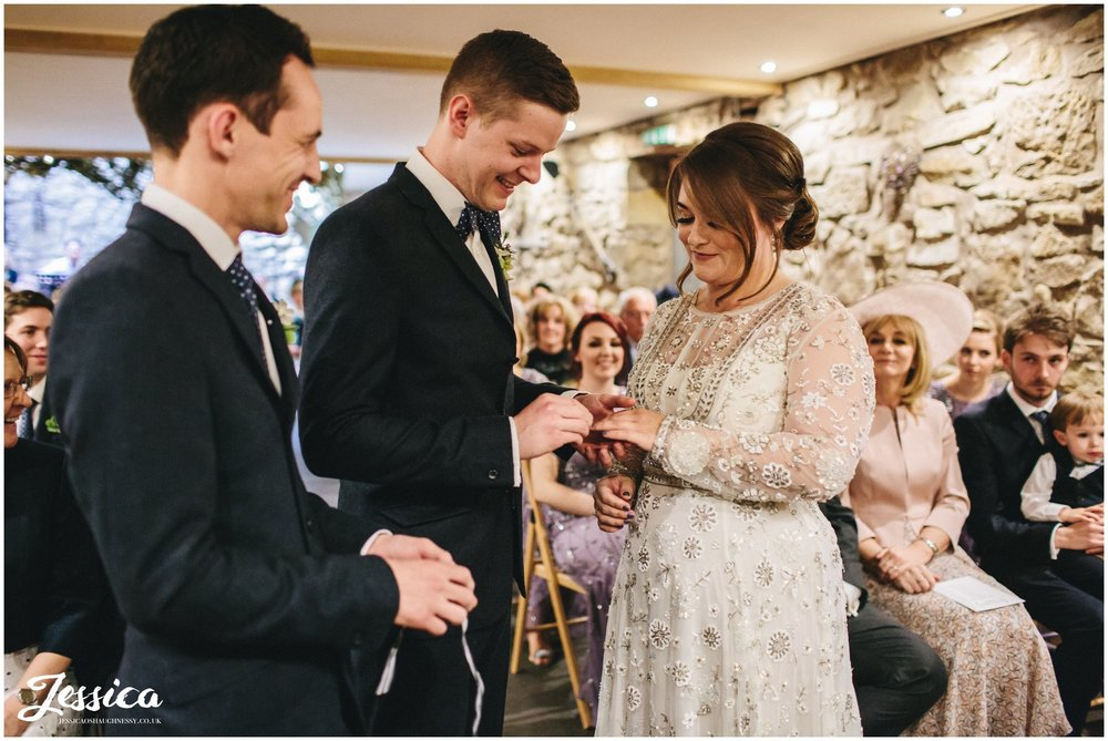 couple exchange rings during their ceremony in north wales
