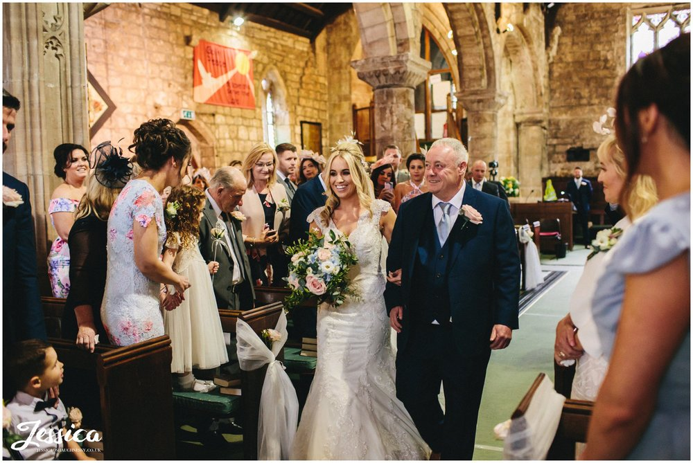 bride & father walk down the aisle for their wirral wedding ceremony
