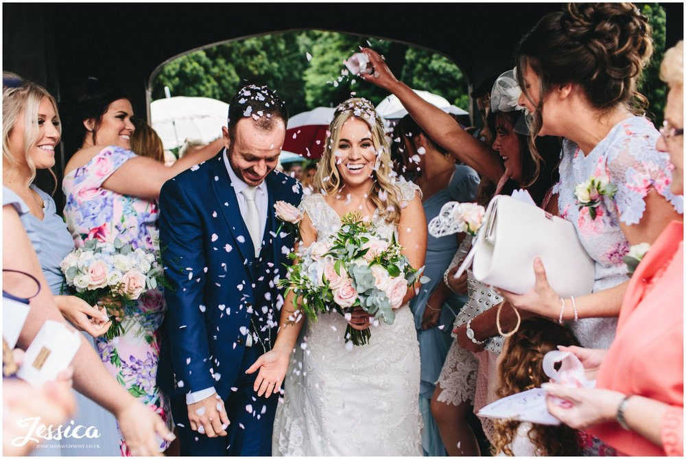 bride gets confetti poured on her head