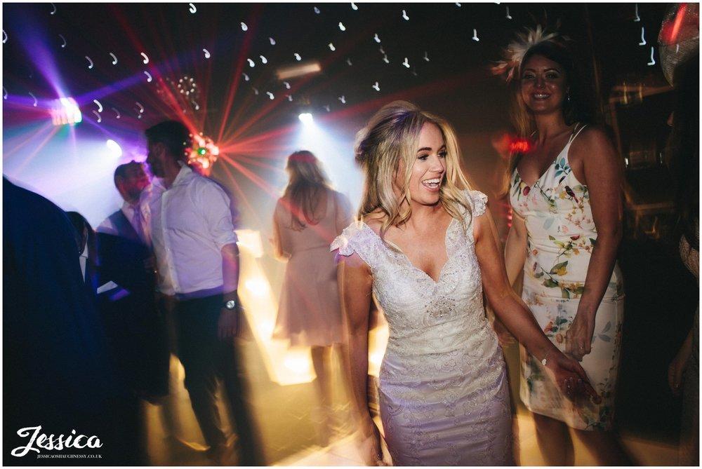 bride dances during her evening of her wedding