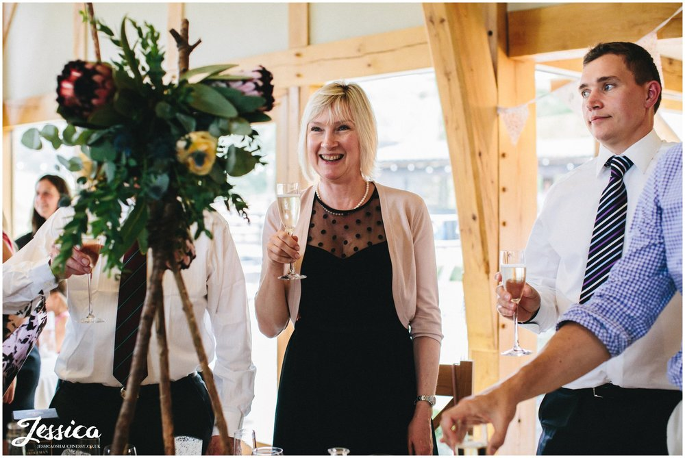 guests toast the newly weds on their north wales wedding day