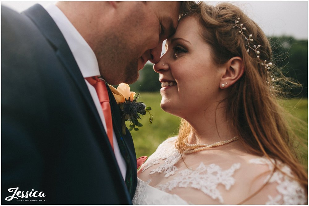 close up of brie & groom taken in the rain