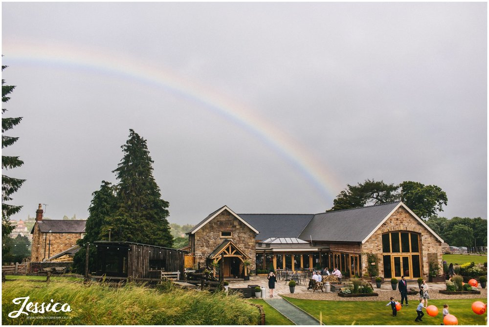 rainbow appears over tower hill barns