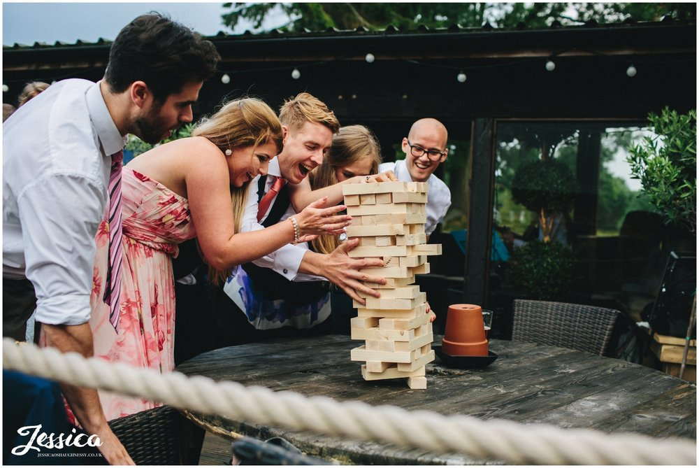 guests play jenga during a wedding in north wales