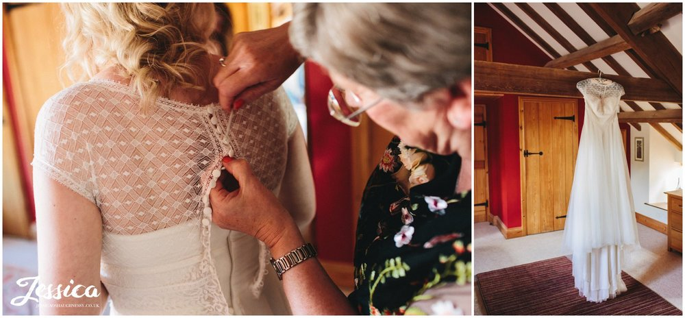 mother of the bride dressing her daughter for the wedding