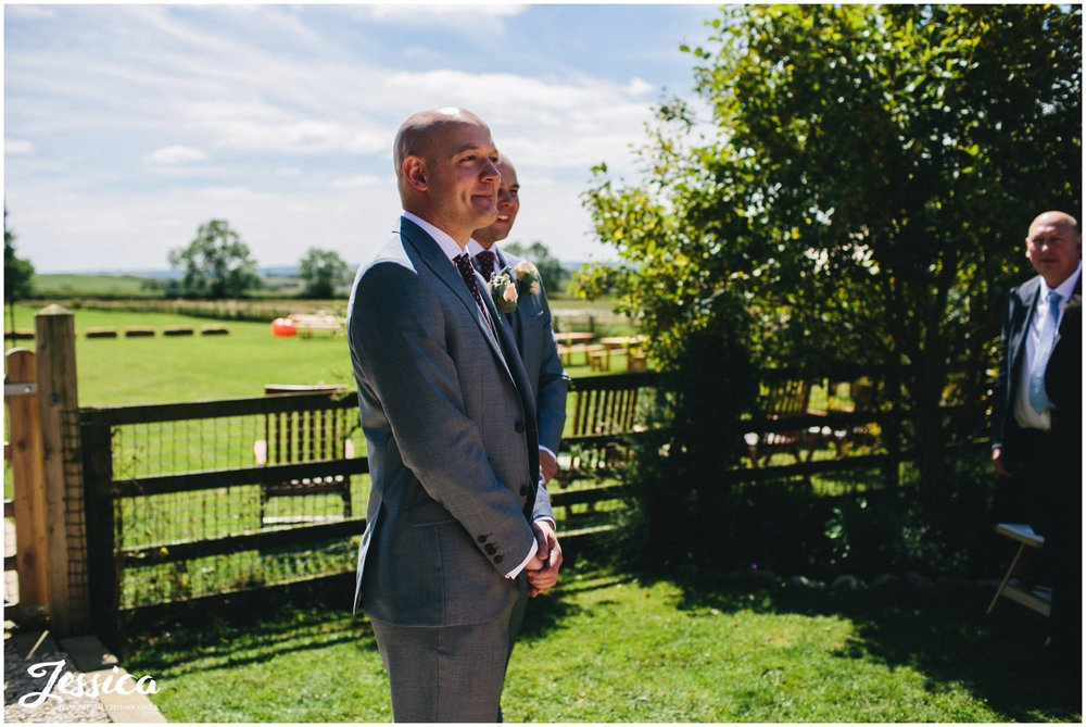 groom waiting for the bride during their wedding ceremony in yorkshire