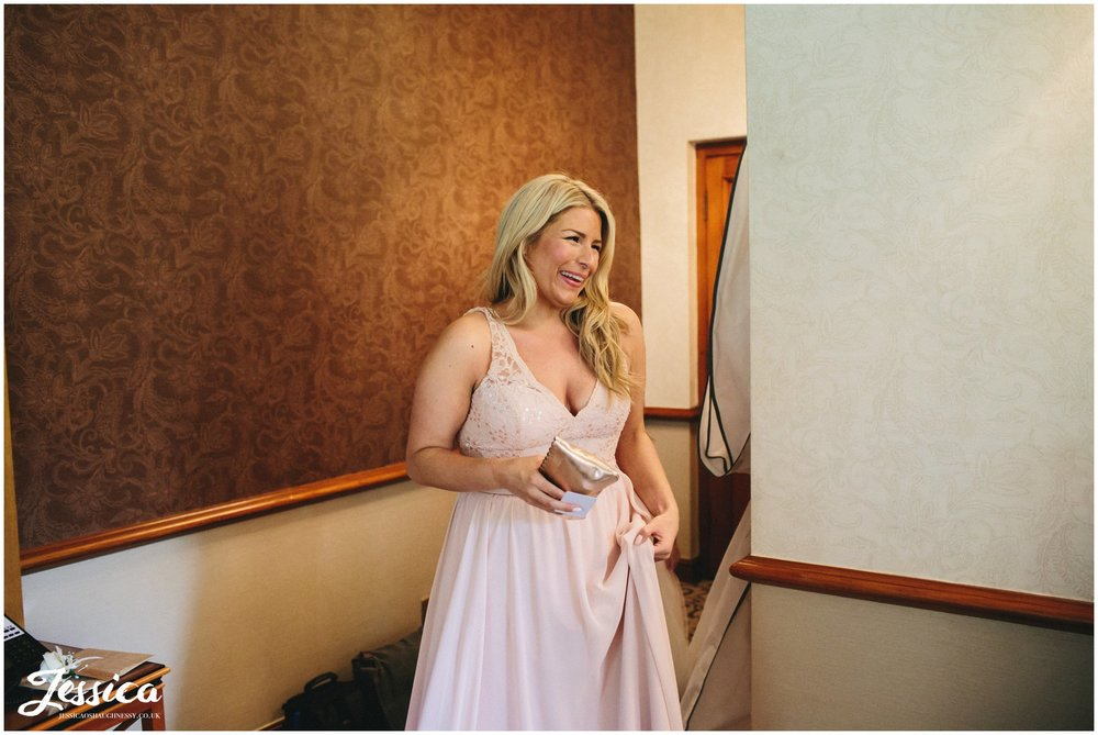bridesmaid sees bride for the first time in her wedding dress