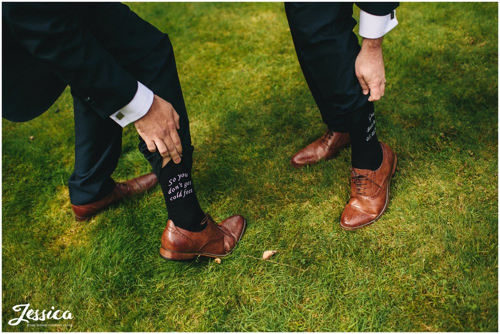 groom shows guest 'so you don't get cold feet' socks