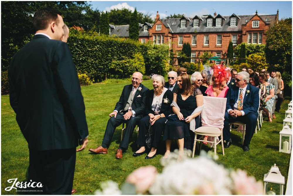 cheshire wedding photography - guests seated ready for ceremony