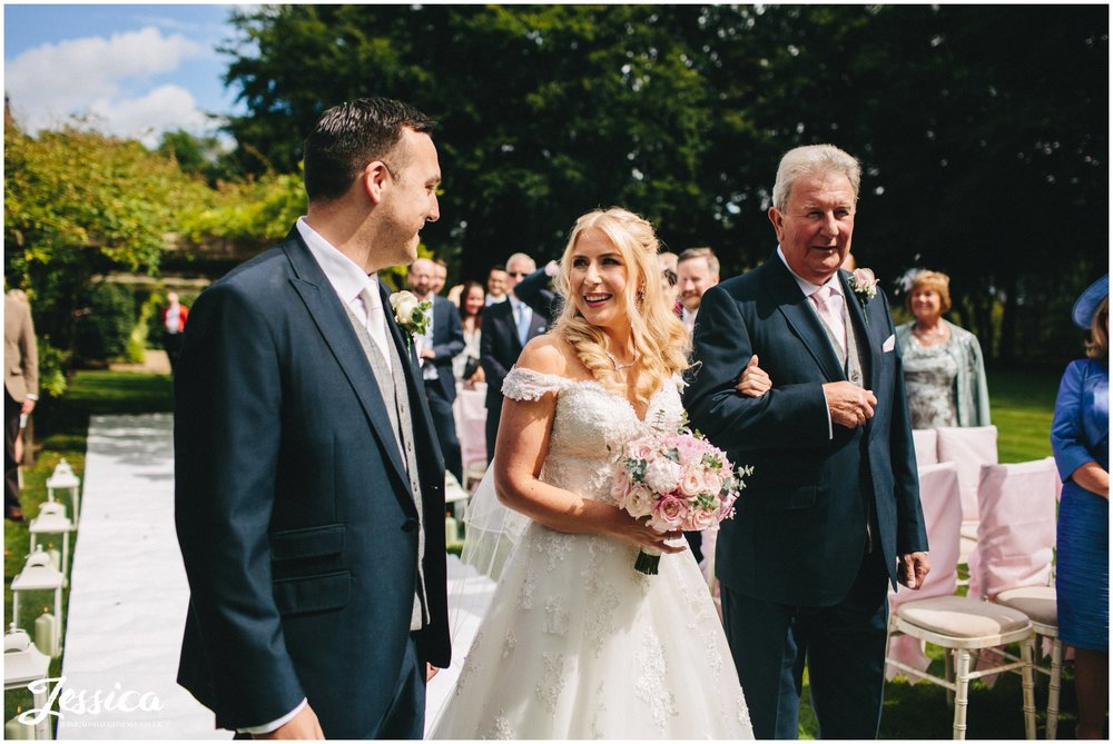 bride sees groom for the first time at a wedding in cheshire