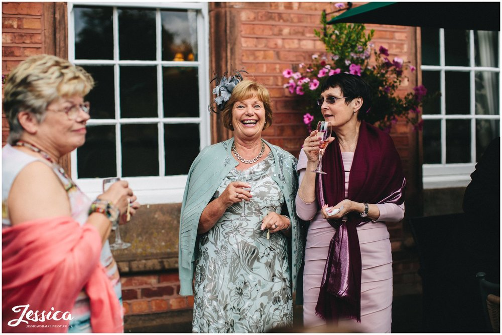 guests laughing after the cheshire wedding ceremony