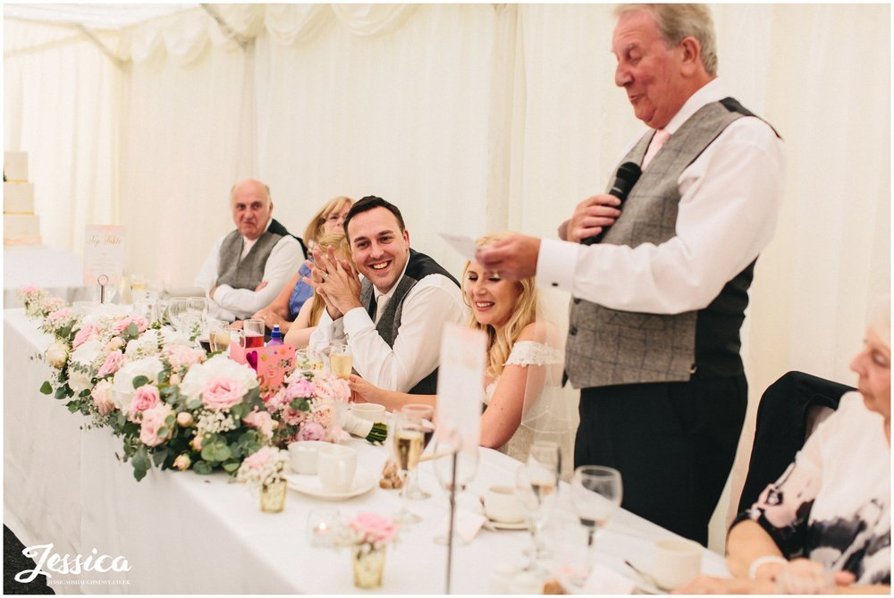 groom laughs during father of the bride speech