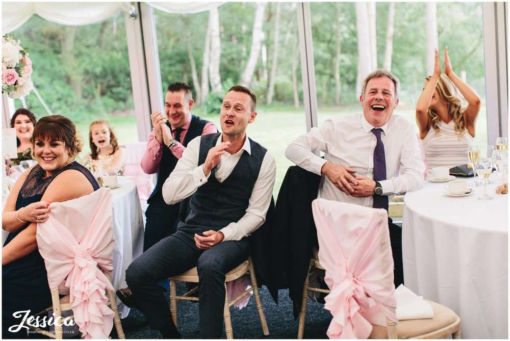 cheshire wedding photography - guests applaud speeches
