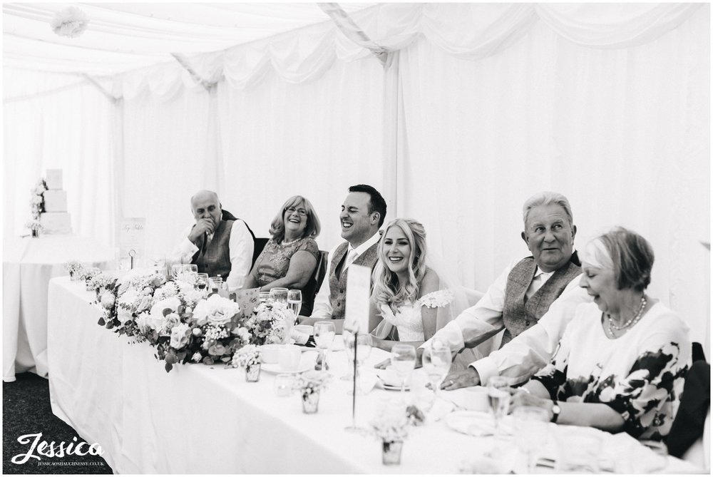 top table enjoying the best mans speech at nunsmere hall
