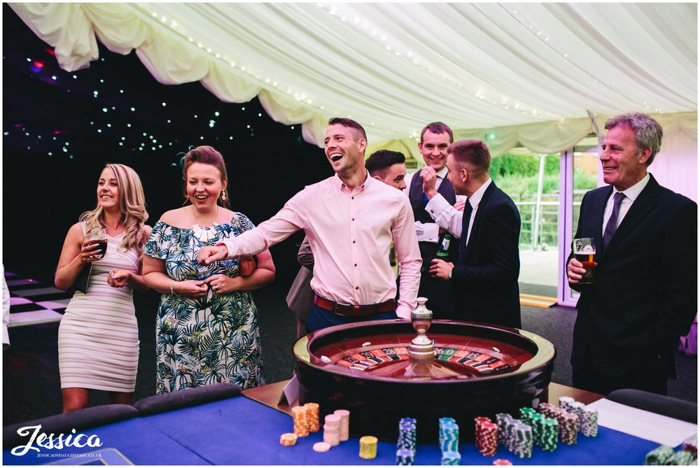wedding guests enjoying playing on the casino