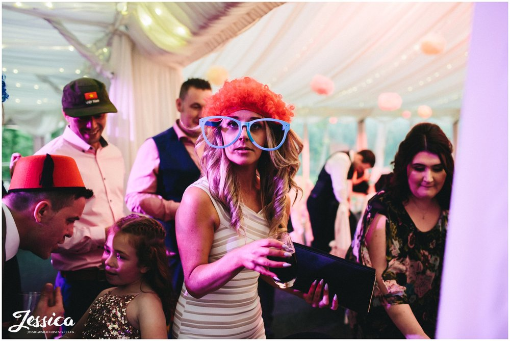 cheshire wedding photographer - wedding guest wearing comedy glasses