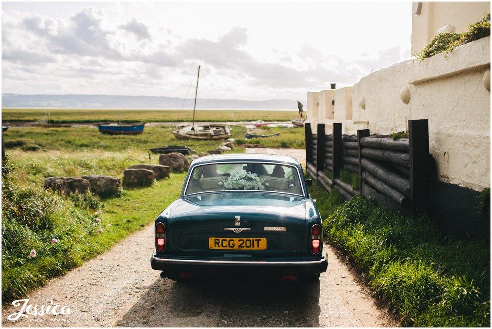 wedding car arrives at sheldrakes restaurant