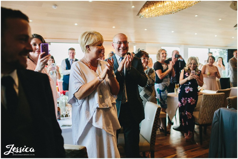 guests applaud as newly wed's enter