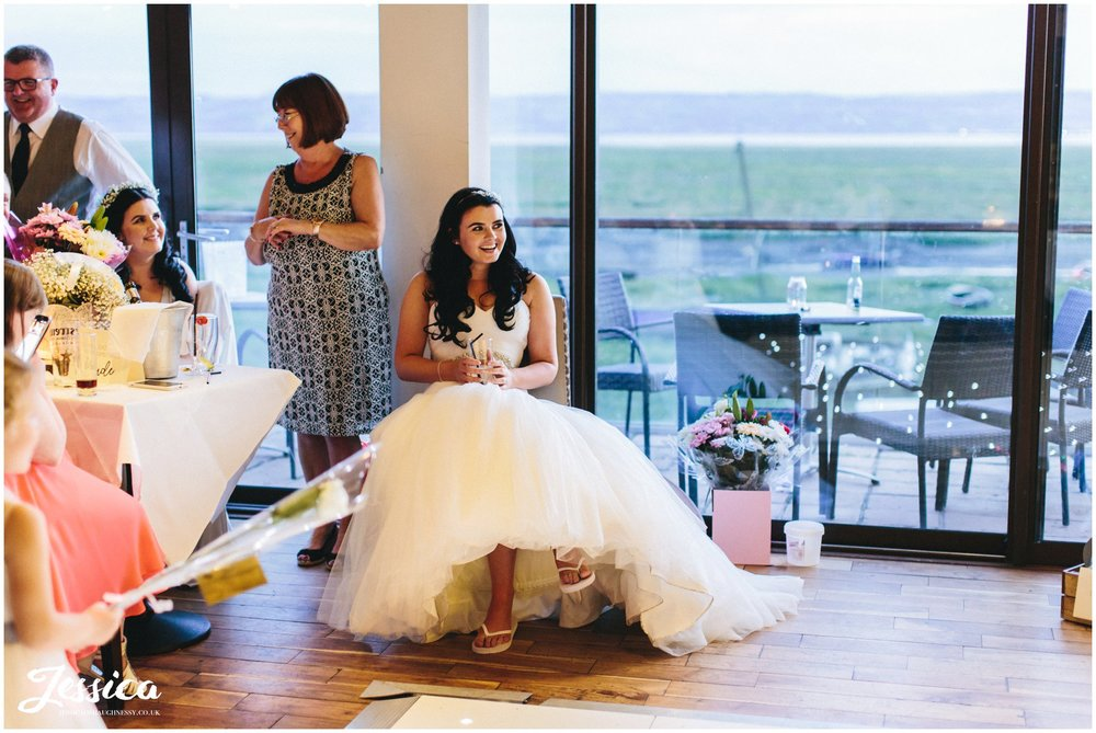 bride enjoys her husbands speech - sheldrakes wedding, wirral