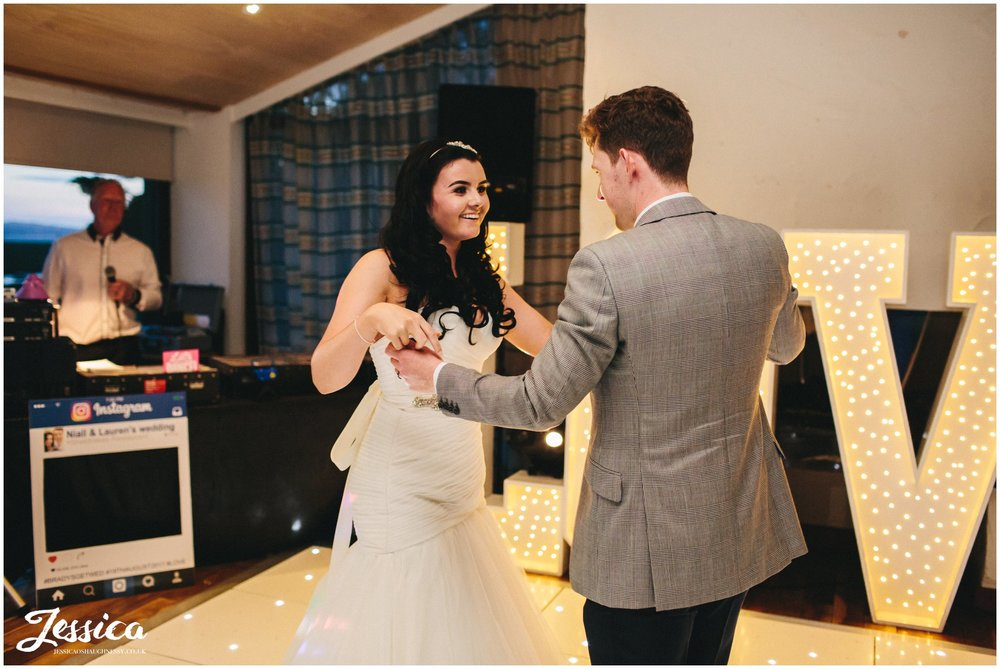 newly wed's share first dance at sheldrakes restaurant