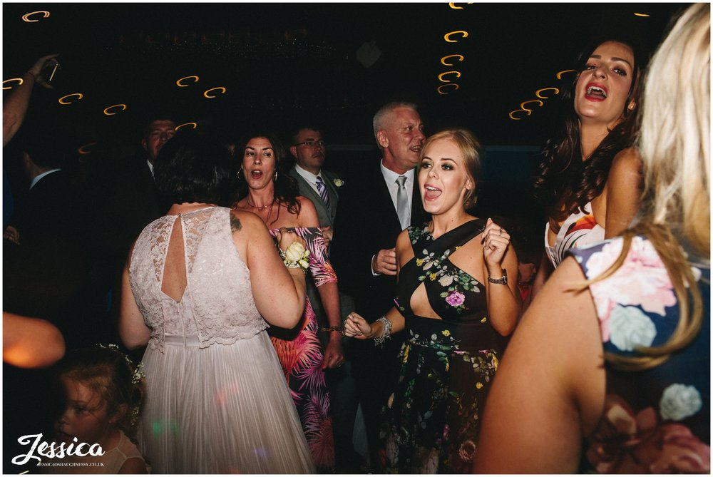 guests singing on the dancefloor - wirral wedding photographer