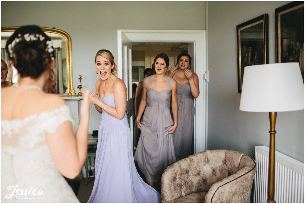 bridesmaids reaction when seeing the bride in her wedding dress