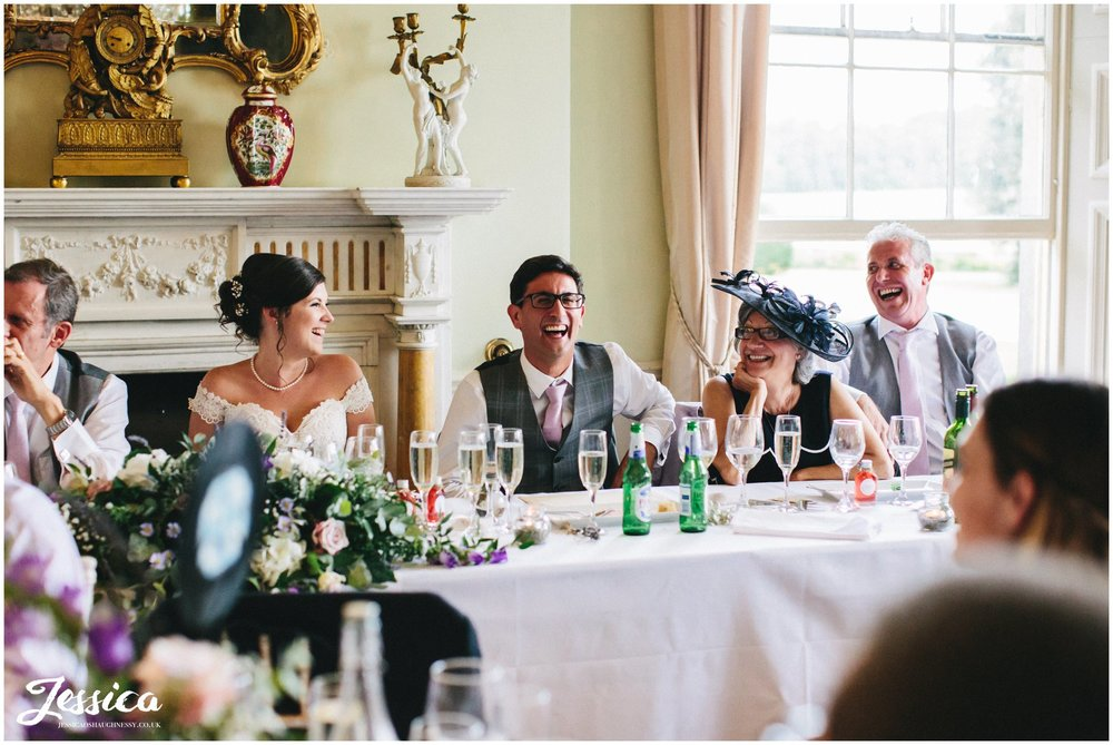 groom laughs during his best mans speech in loughborough