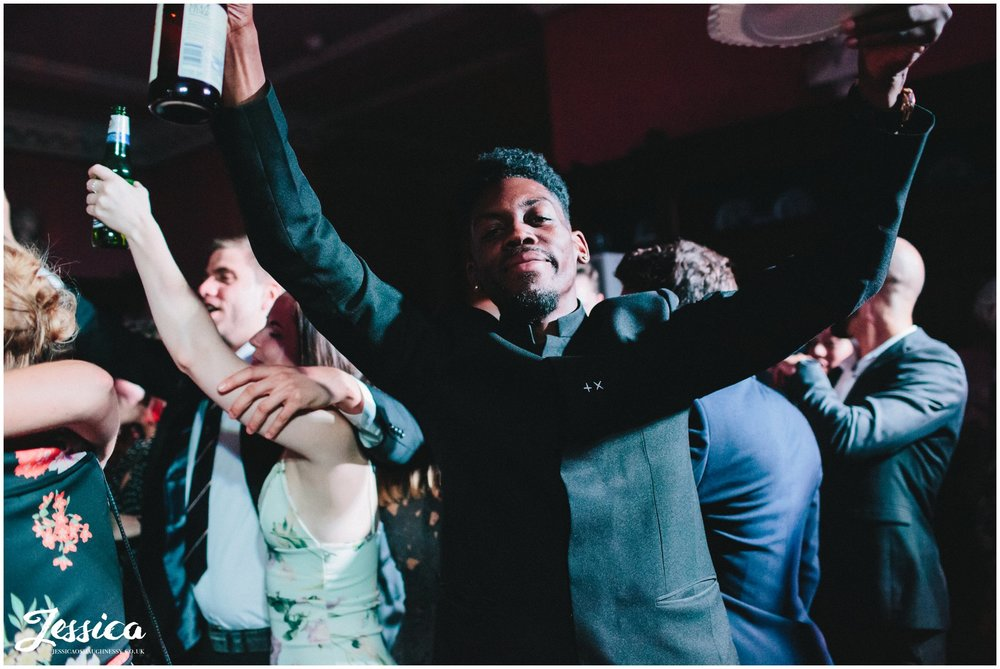 guests dance with hands in the air