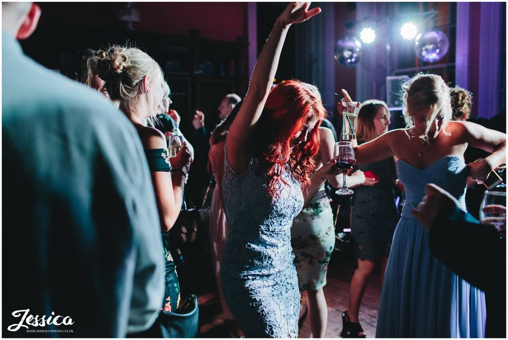 guests celebrating by dancing during the wedding reception - prestwold hall wedding