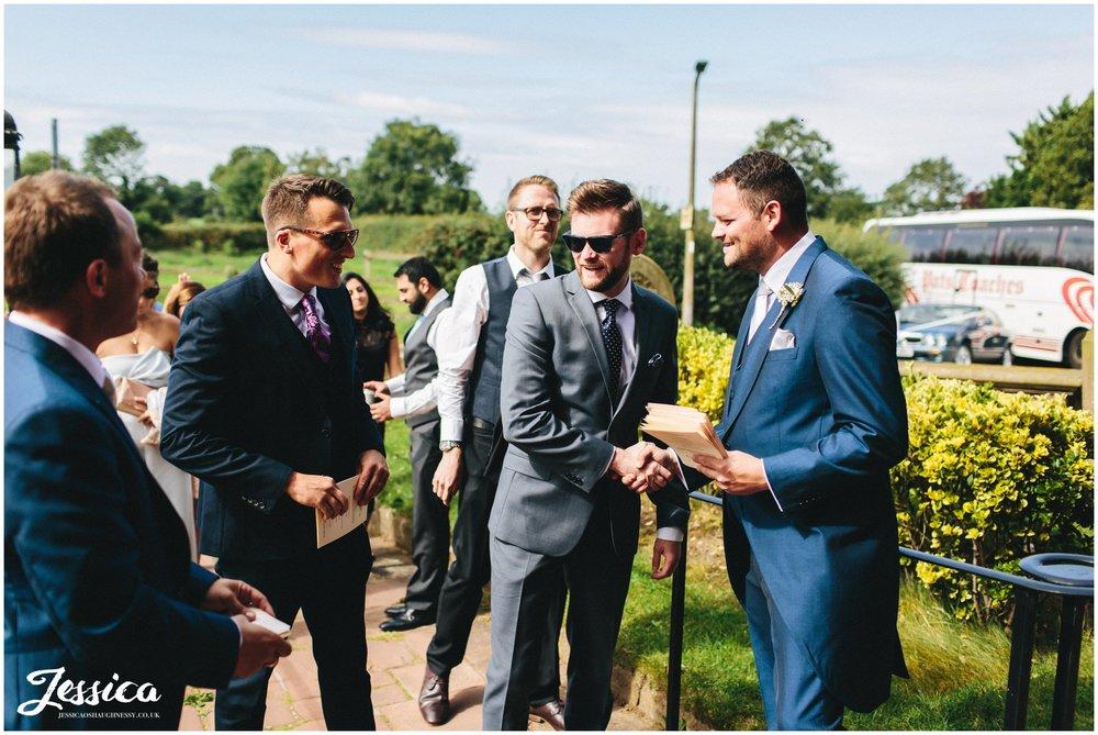 groomsmen great arriving wedding guests in waverton