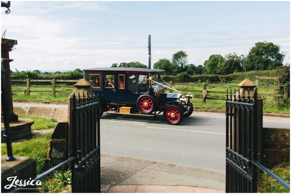 bridal car arrives at St. Peter's Church in waverton
