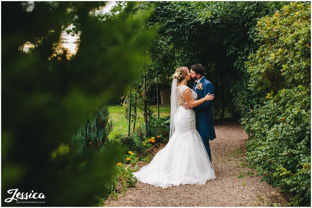 newly wed's kiss during their wedding photographs