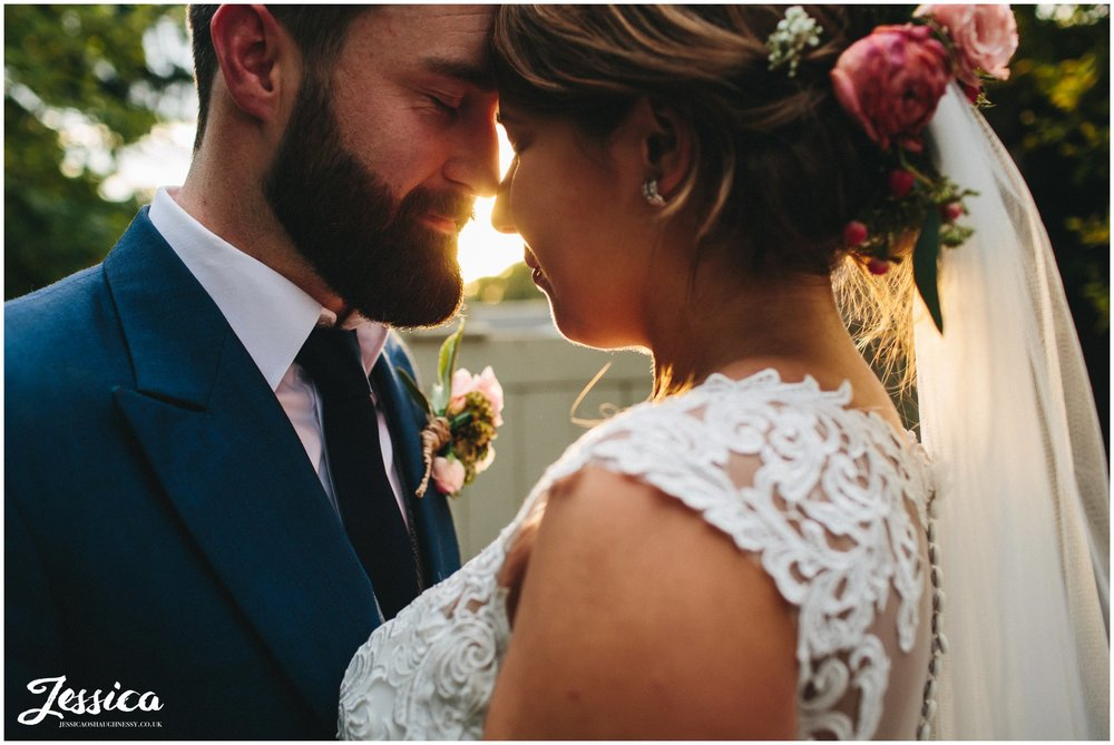 couple share intimate moment during golden hour in cheshire