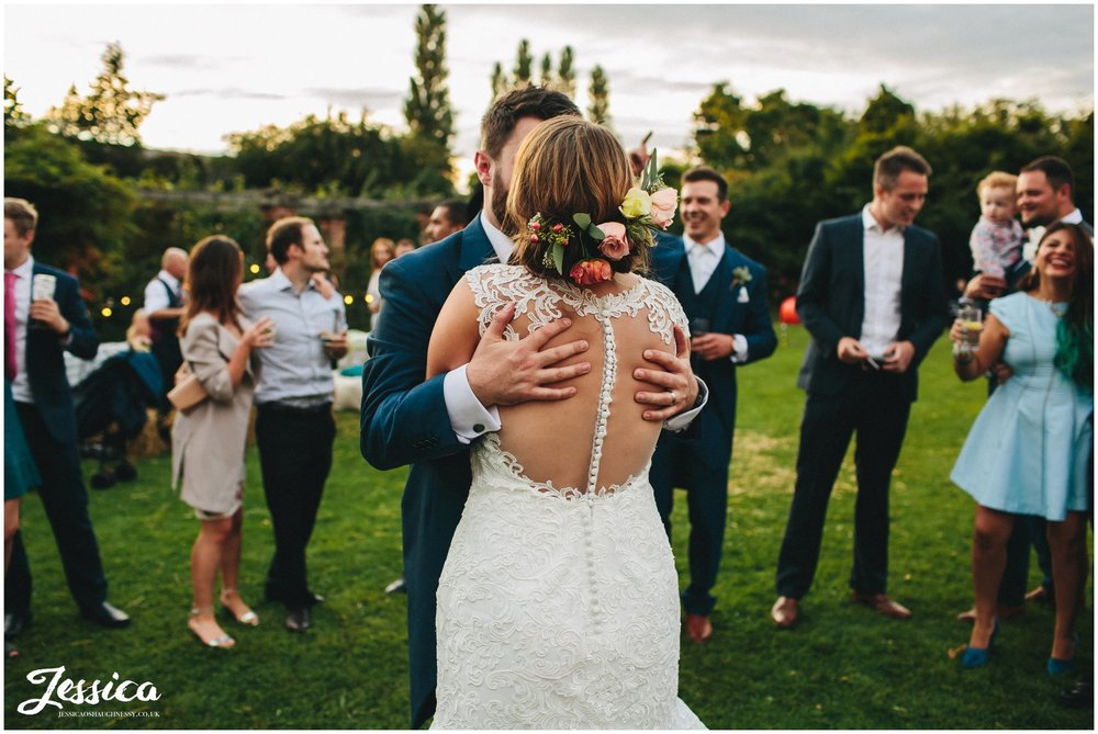 newly wed's kiss during their outdoors first dance at willington hall